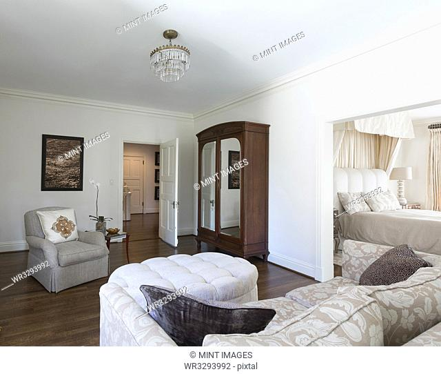 Wardrobe and sofa in ornate bedroom