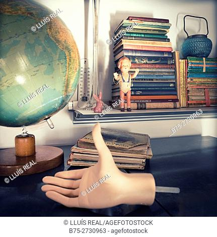 Still life with a balloon, the hand of a manikin, books, a doll, etc