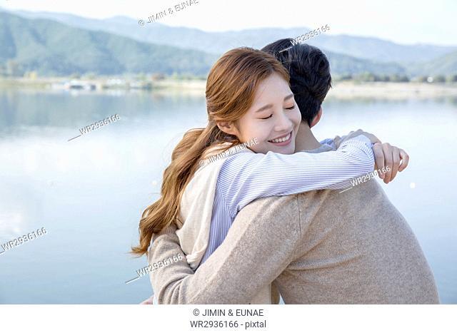 Loving couple travelers hugging