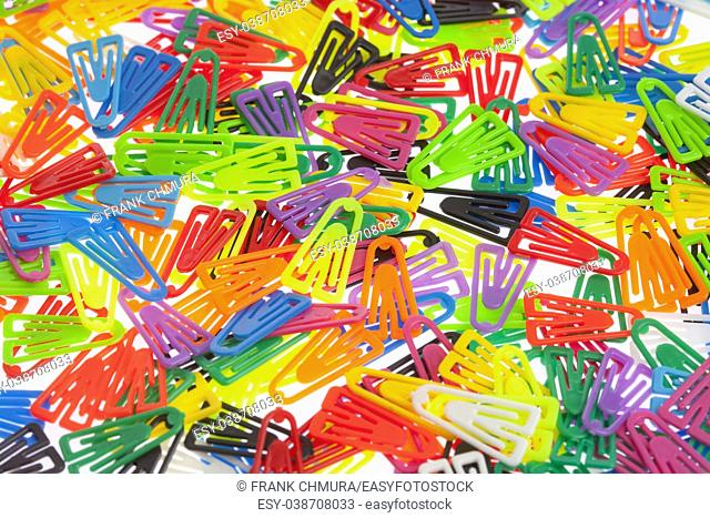 Closeup of Many Colored Paper Clips on White