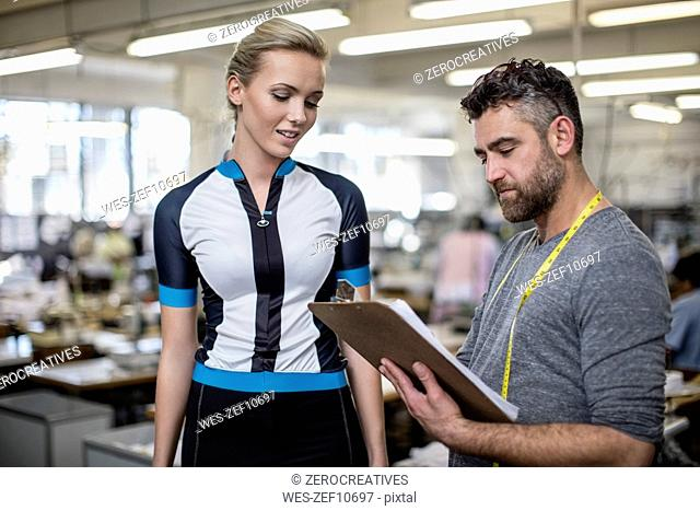 Tailor with model fitting sportswear