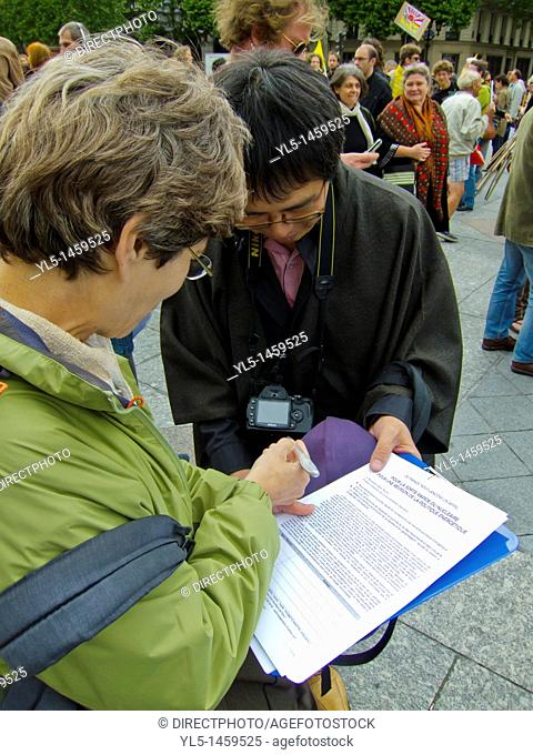 Paris, France, Demonstration Against Nuclear Power, Japanese Citizens Signing Petitions to stop Nuclear Energy