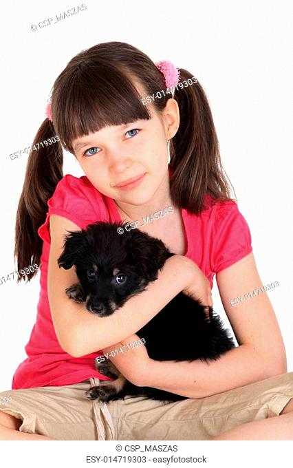 Girl with small puppy dog