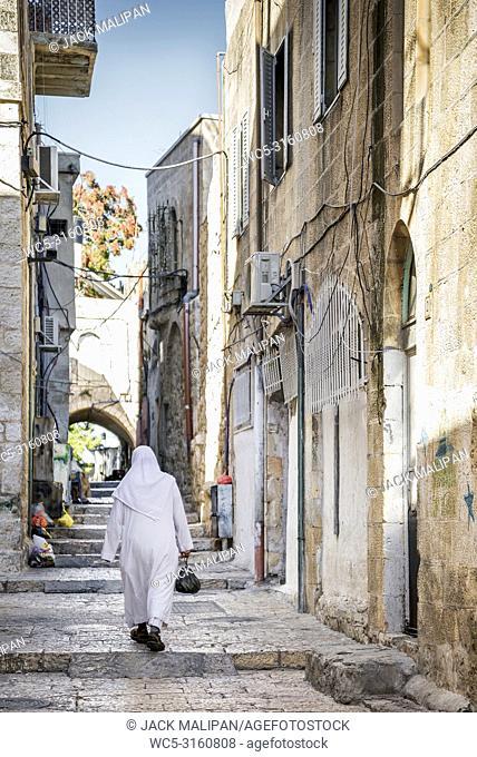 palestinian people in old town cobbled street scene of jerusalem city israel