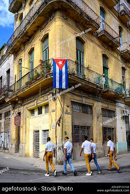 Schoolboys, Building and flag at Brasil and Aguacate, Havana, Cuba