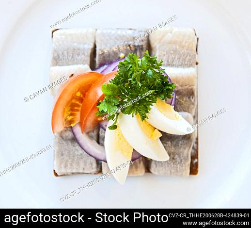 close up of smorrebrod with herring at Icelandic restaurant