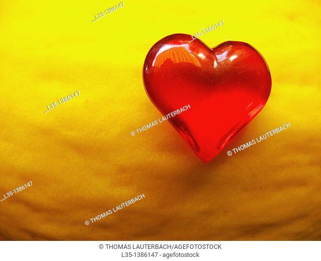 Little red glass heart on a melon