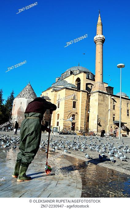 Man cleans fountain near mosque, Konya, Turkey