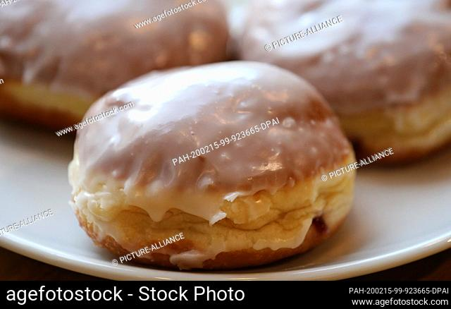 14 February 2020, Mecklenburg-Western Pomerania, Rostock: ILLUSTRATION - doughnuts or pancakes lie on a plate at a bakery