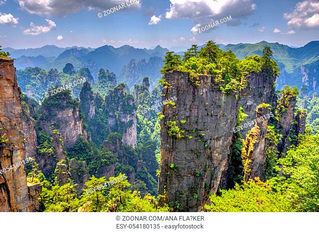 View over tall sandstone columns and formations in Zhangjiajie national park, Hunan, China. HDR image