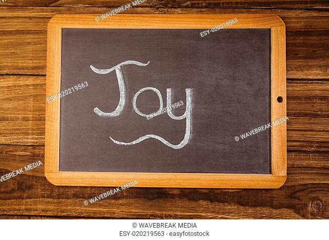 Chalkboard on table with joy text