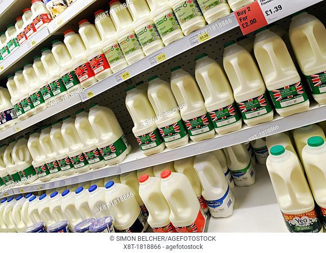 Milk on the Shelves of a Supermarket Aisle, UK
