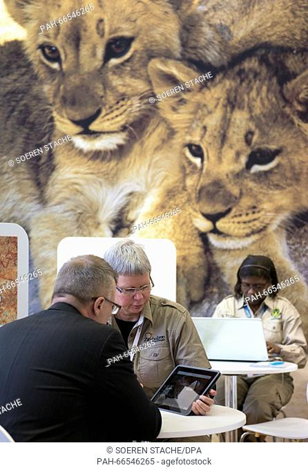Young lions on a poster can be seen at the stand of Zimbabwe at the International Tourism Fair (ITB) in Berlin, Germany, 9 March 2016