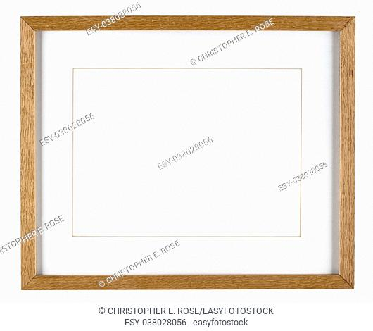 Empty picture frame isolated on white in oak wood with a mount