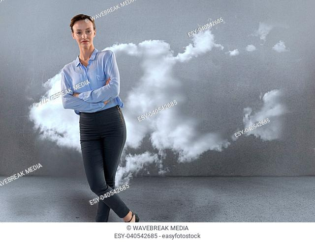 Businesswoman in room leaning by cloud