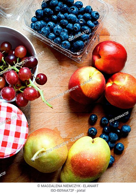 Blueberries, grapes, peaches and pears, overhead view