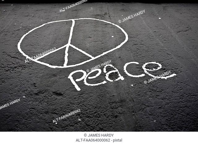Peace sign and the word peace painted on the Berlin Wall, Berlin, Germany