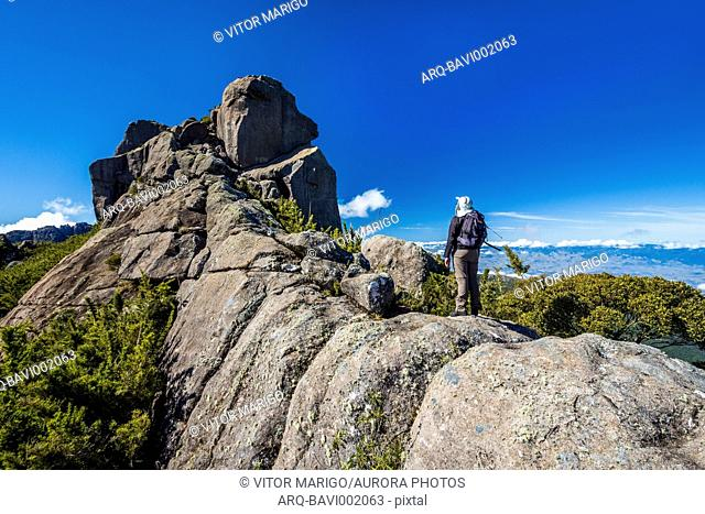 Photograph of man hiking to Couto Mountain (Morro do Couto) in Itatiaia National Park, Rio de Janeiro state, Brazil