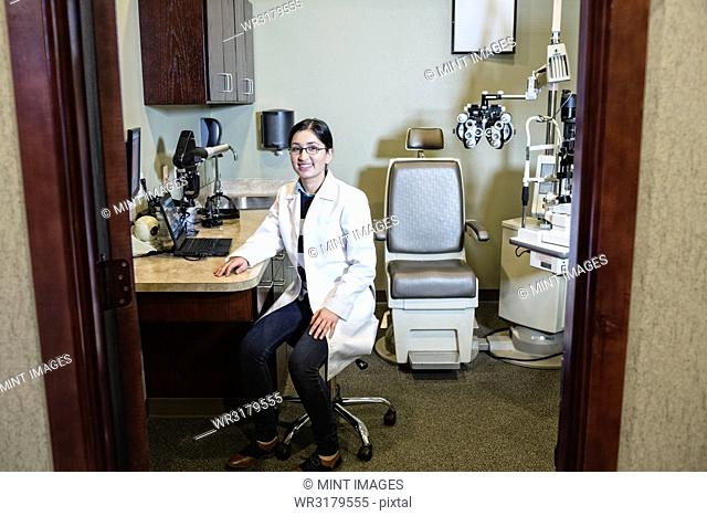 East Indian woman ophthalmologist in her office examination room