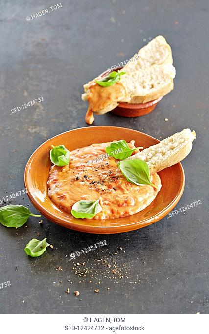 Pizza fondue with bread and basil