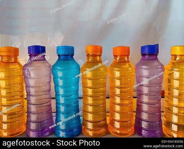 Colorful platic water bottles filled with water