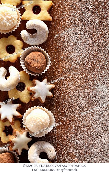 Christmas cookies on wooden background with copy space