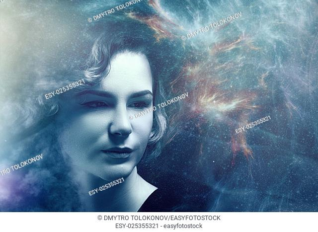 Fantastic female portrait with space nebula and lights, science and education backgrounds