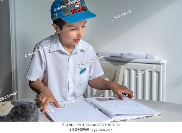 Schoolboy reading out his diary