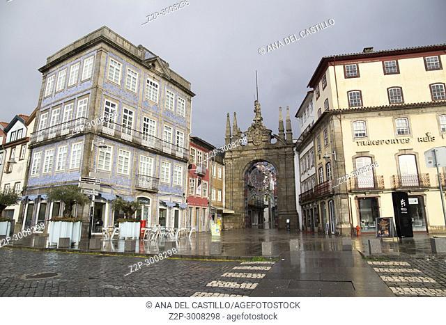 Citylife in Braga a rainy day. Portugal. Arch of Rua Souto