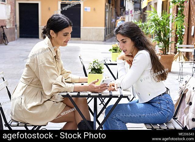 Two young girls enjoying a morning of shopping