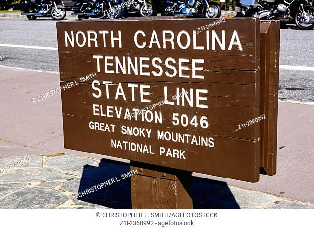 North Carolina and Tennessee State Line signpost at the top of the Great Smoky Mountains National Park