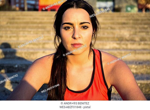 Portrait of confident female athlete