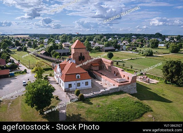 Drone view of Gothic ducal castle from 15th century on the bank of Liwiec River in Liw village, Masovian Voivodeship of Poland