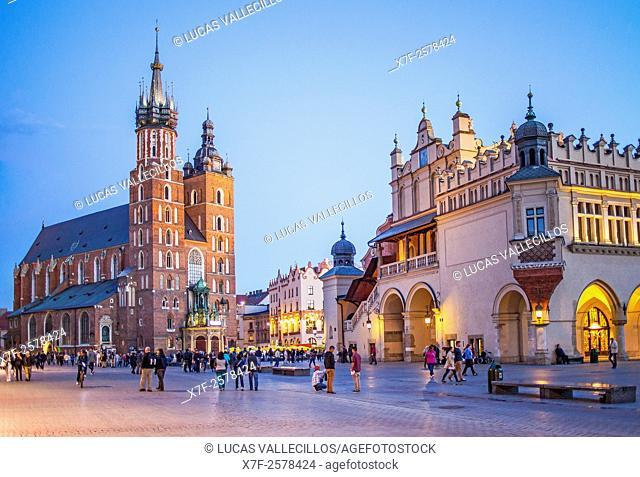 St. Mary's Basilica and Sukiennice Cloth Hall, at main Market Square Rynek Glowny, Krakow, Poland