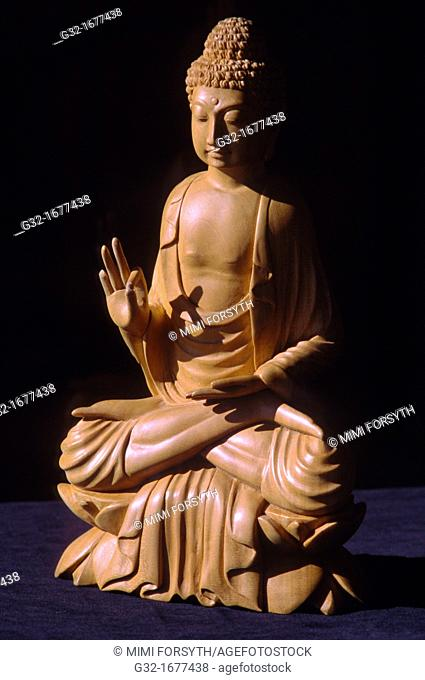 Indonesian carved wood Buddha, Vitarka mudra intellectual argument, the wheel of law
