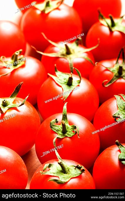 Red tomatoes arranged at the market stand