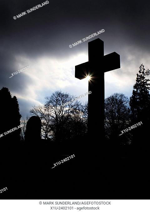 Cross Silhouette with Sun Flare Ripon Cathedral Churchyard North Yorkshire England