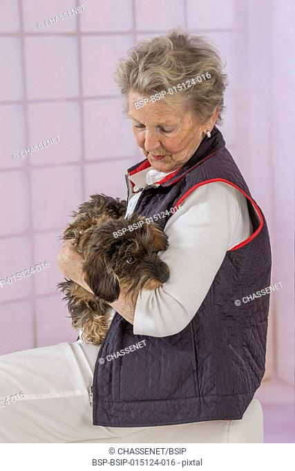 Senior woman with her dog