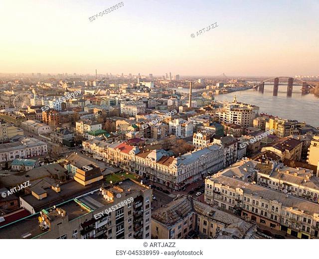Aerial panoramic view from the drone to the oldest district of Kiev - Podol, Sahaidachnoho street, the Podolsky bridge, Havana bridge