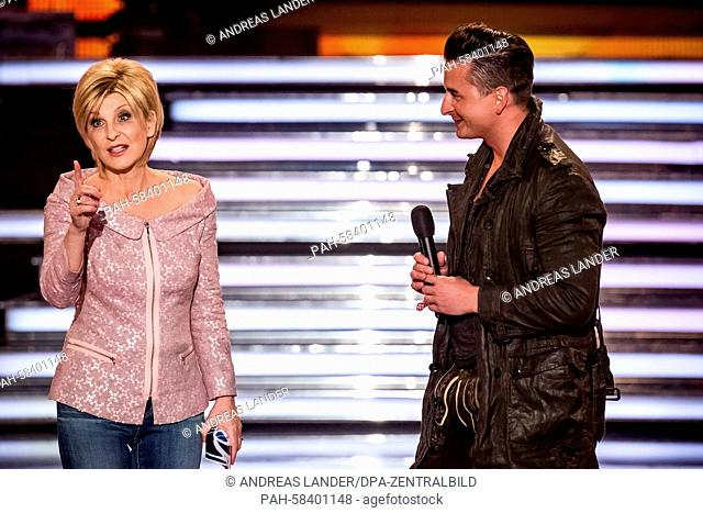 Presenter and television host Carmen Nebel (L) and Austrian singer Andreas Gabalier stand on stage during the German television show 'Willkommen bei Carmen...