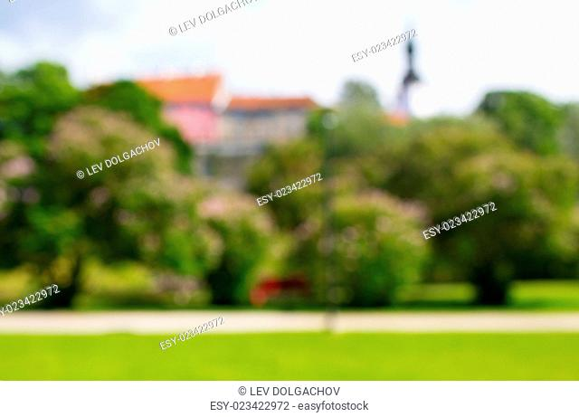 nature, season, background and landscape concept - blurred summer old city and park bokeh