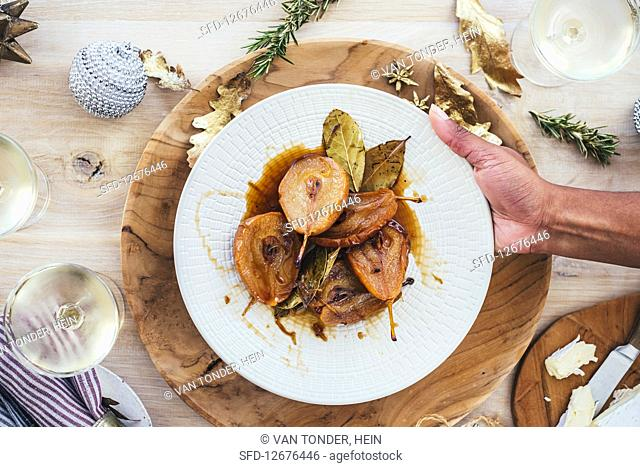 Roasted pears in sweet wine with laurel served with brie