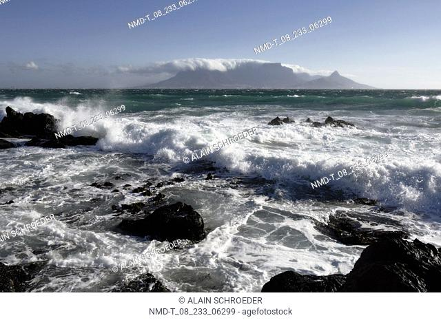 High angle view of waves breaking against rocks in the sea, Blaauwberg Strand, Cape Town, Western Cape Province, South Africa