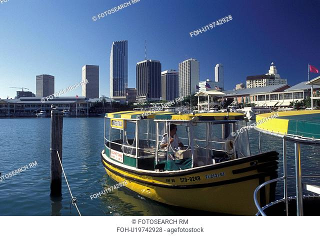 water taxi, skyline, Miami, FL, Florida, Atlantic Ocean, Yellow water taxi docked outside Bayside Marketplace, a shopping, dining, entertainment mecca