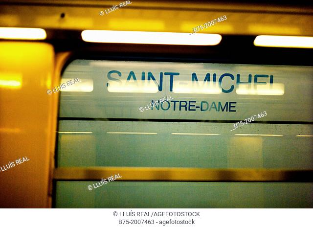 platform indication of Saint-Michele Notre-Dame, seen from the wagon of the Metro in Paris, France