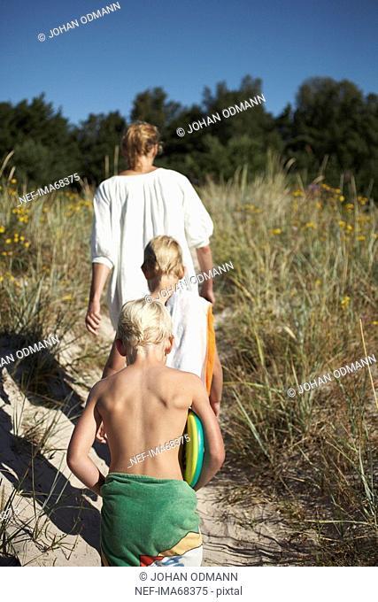 A family leaving the beach Gotland Sweden
