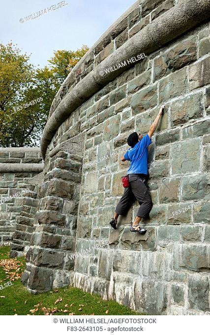 Rock climber practicing in city park, Parc des Champs-de-Bataille, Quebec City, Quebec, Canada