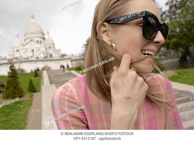 fashionable blogger woman in front of touristic sight Basilica Sacré-Cœur, during fashion week, in city Paris, France, in city Paris, France