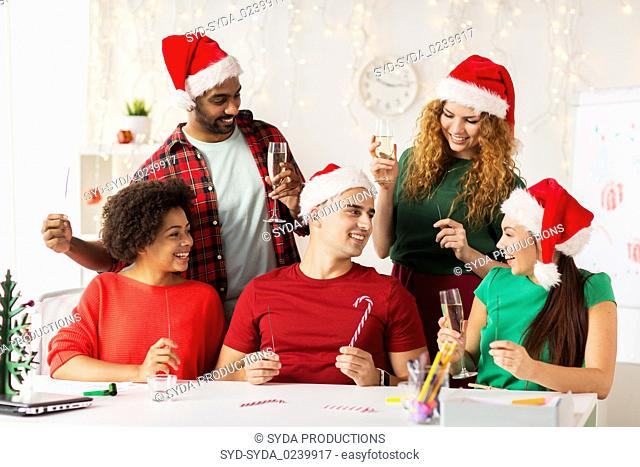 happy team celebrating christmas at office party