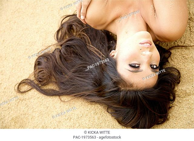 Hawaii, Kauai, Kealia Beach, Attractive Young Woman On The Beach Topless